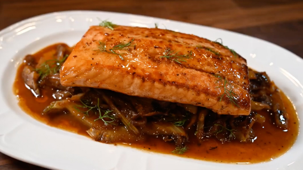 Salmon covered in maple bourbon sauce