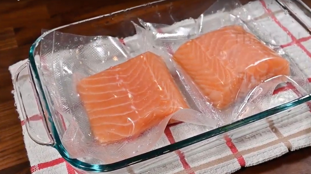 Two frozen pieces of salmon